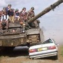 A tank rolls over a car